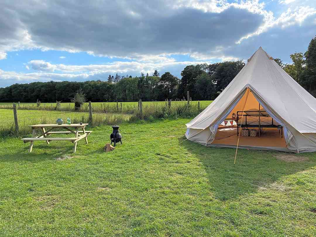 Bell tent with chiminea and picnic bench