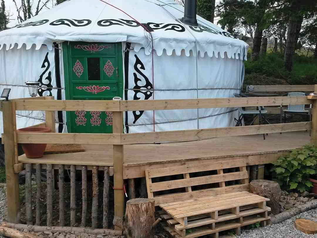 The Tall Pines Yurt: Yurt showing outside bench and decking