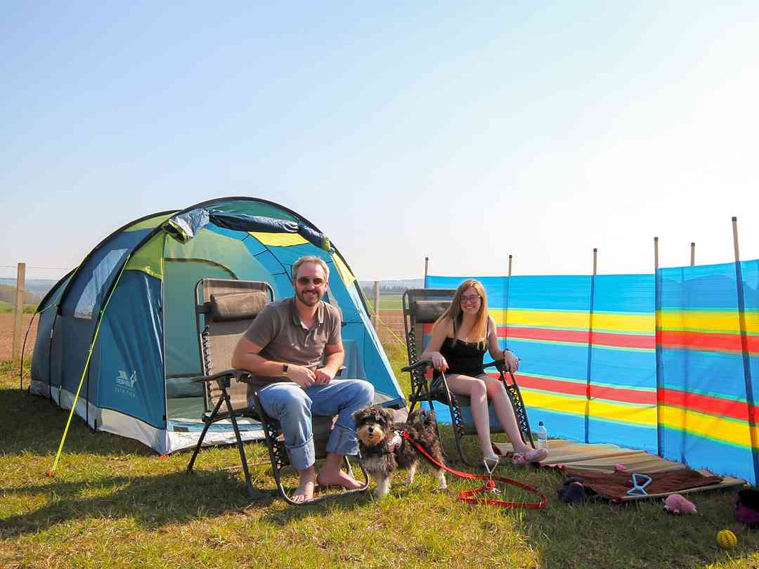 A couple and their lovely dog Pepper enjoying a weekend in the sun in our large camping field