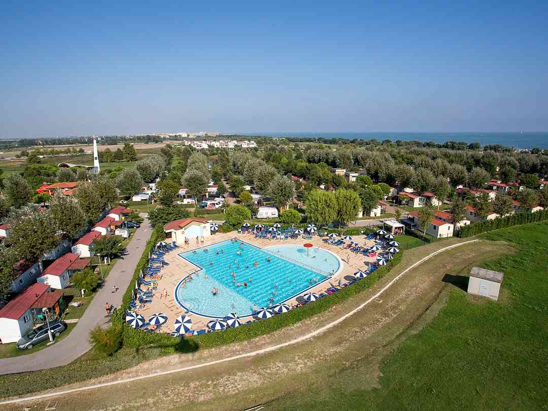 Aerial view of the site and its pool