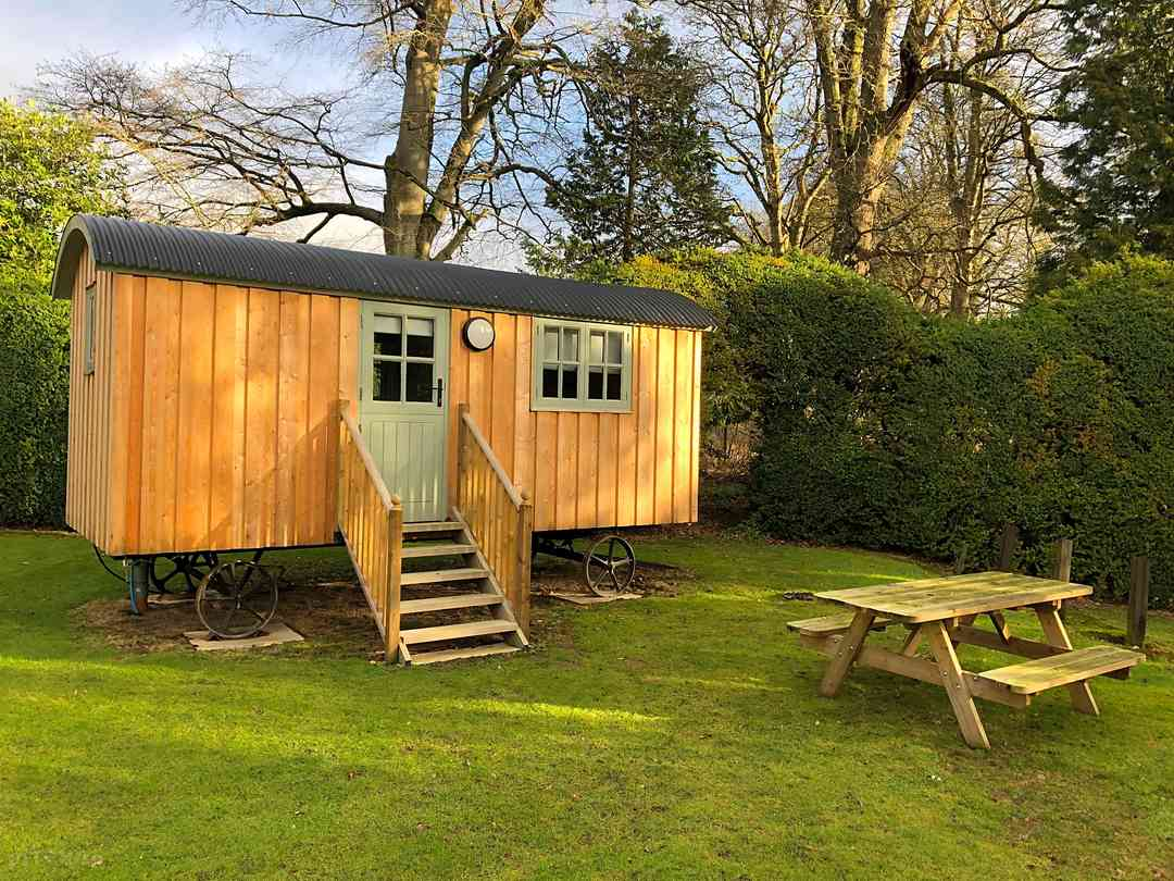 Shepherd's hut exterior with picnic table