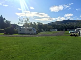 Electric hardstanding pitches with excellent views of the Campsie hills