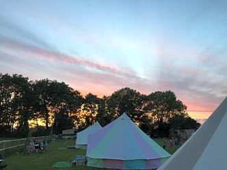 Bell tents at sunset