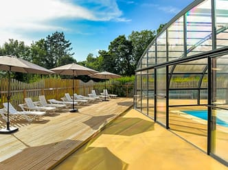 Solarium with sunbeds and umbrellas by the pool
