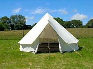 Canvas bell tent pitched and ready