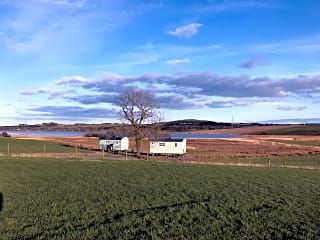 The huts are in a peaceful spot overlooking Loch Fitty