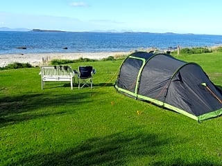 Pitch your tent steps from the beach.