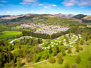 Aerial view of Callander Woods, with Callander and the Trossachs in the background