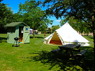 Bell tent with cooking cabin