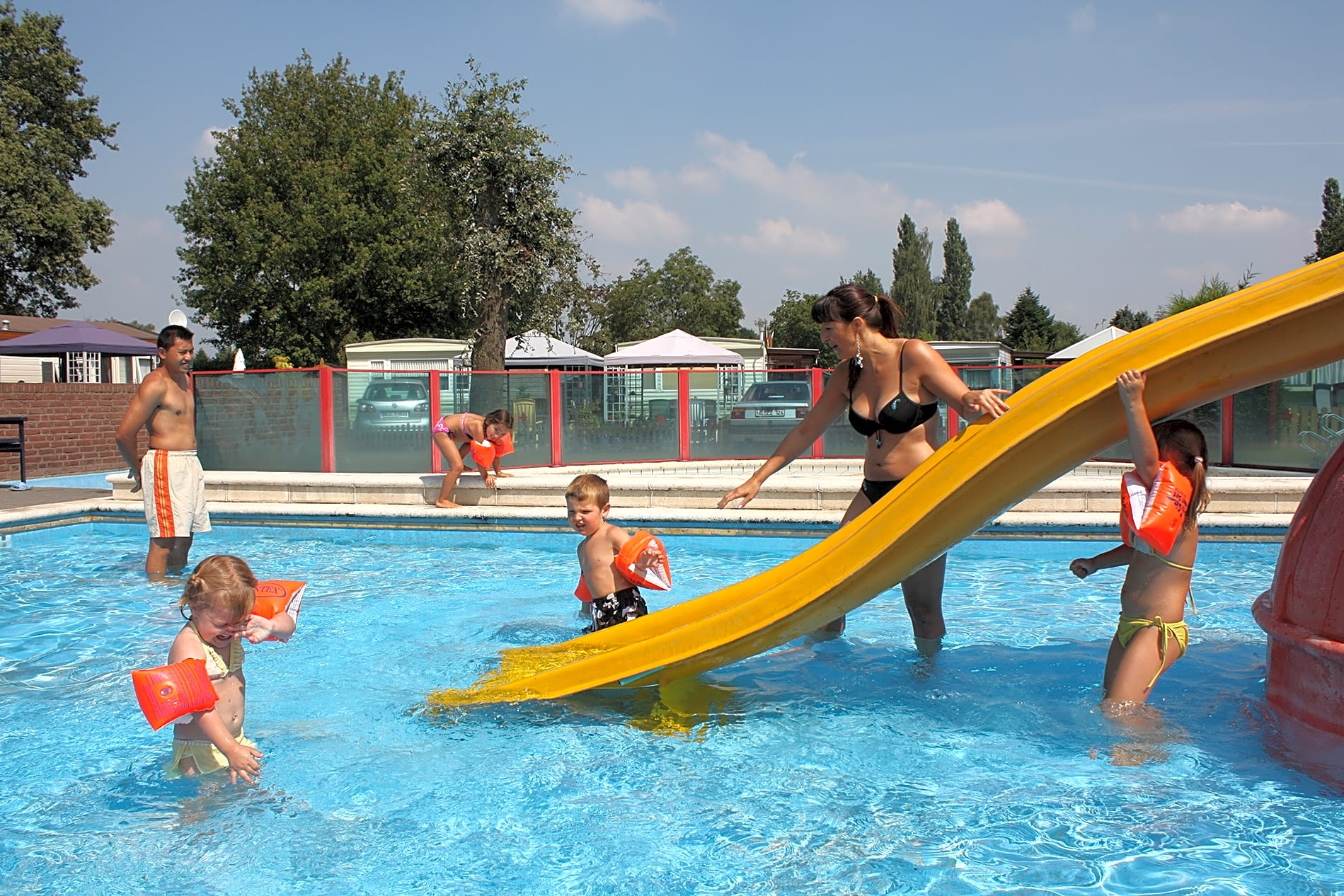 Outdoor pool with slide