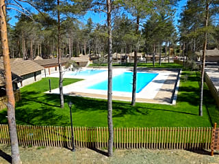 Outdoor pool and grassy terrace