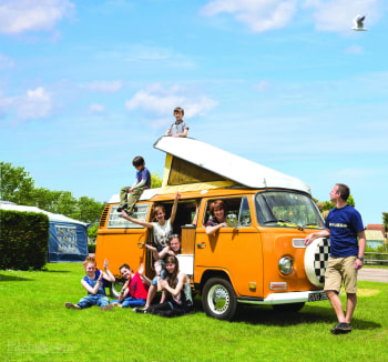 Grouping around a VW camper