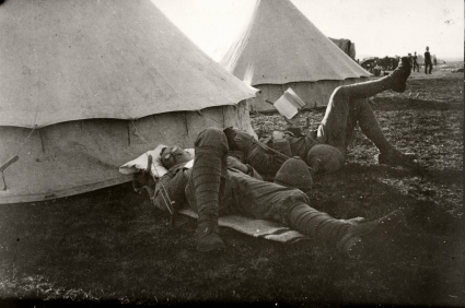 Soldiers relaxing by tent