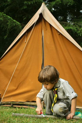 Young scout preparing camp