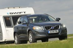 The Volvo XC60 touring a Swift