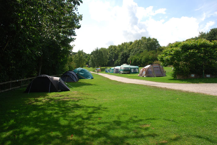 Spacious camping areas at Newton Mill Holiday Park, Bath