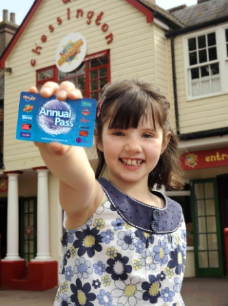 Girl holding Merlin Annual Pass