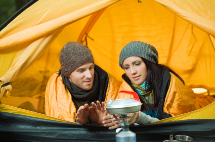 Young couple winter camping
